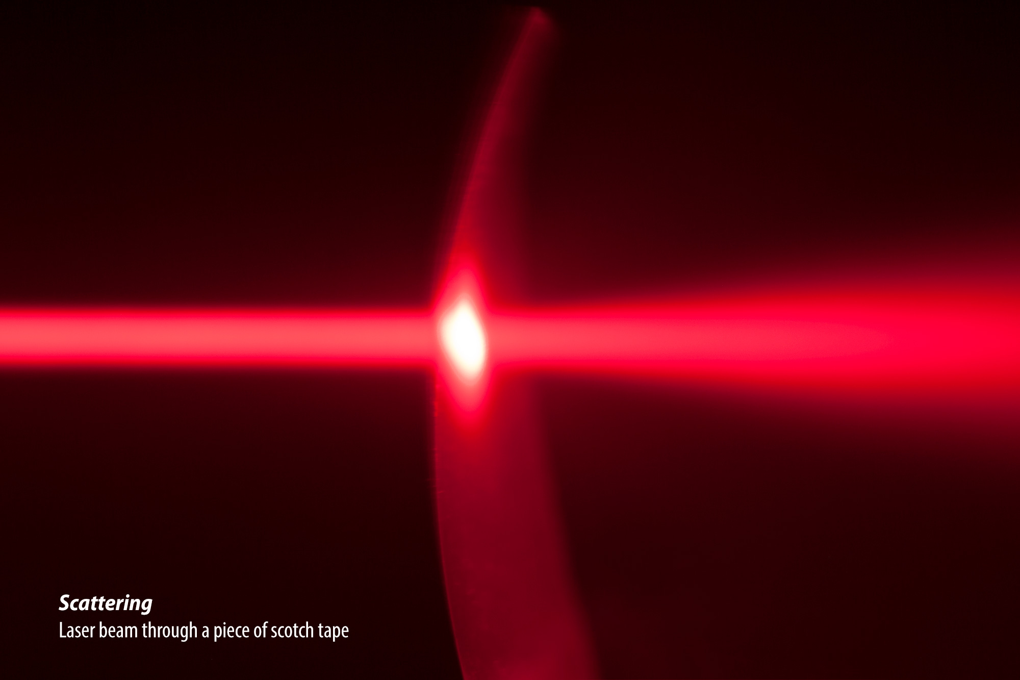 Laser beam through a piece of scotch tape